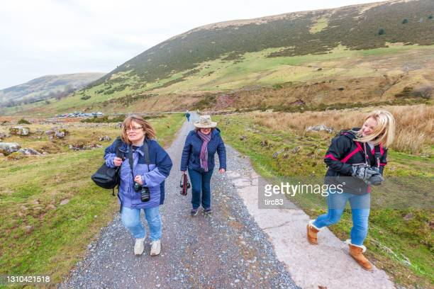 group of friends on welsh countryside hike - 2015 stock pictures, royalty-free photos & images