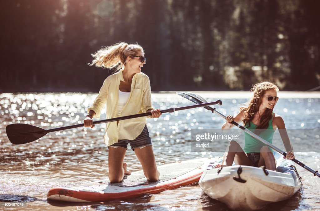Group of Friends Paddle Boarding (sup) on Lake : Stock Photo