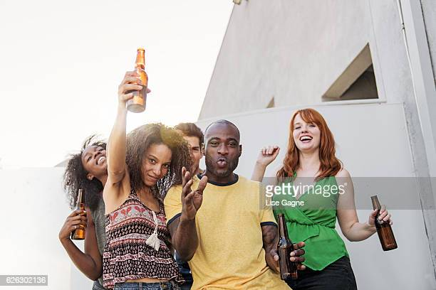 Group of friends partying on balcony