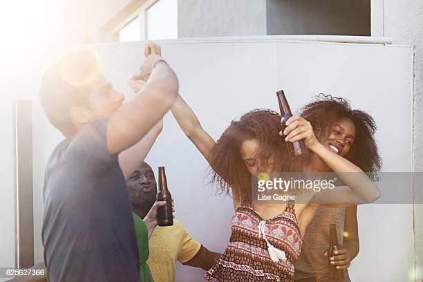 Group of friends partying on rooftop
