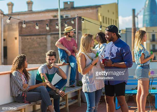 Group of friends partying on rooftop terrace