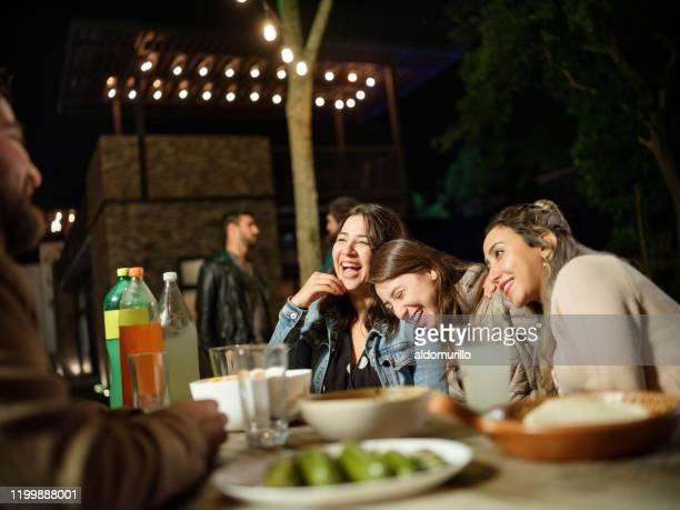 group of friends partying outdoor at night - carne assada imagens e fotografias de stock
