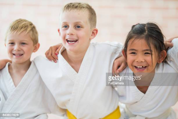 group of friends - taekwondo kids stock photos and pictures