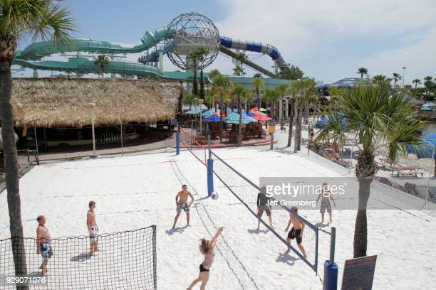 A group of friends playing a game of volleyball at the Wet'n Wild water park