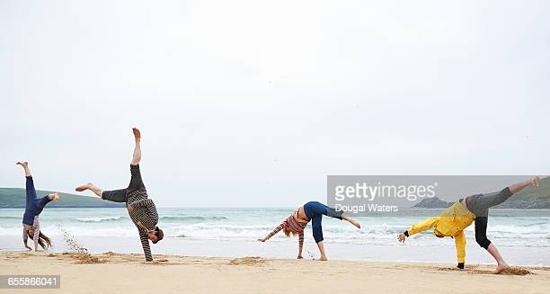 Group of friends playing at beach.