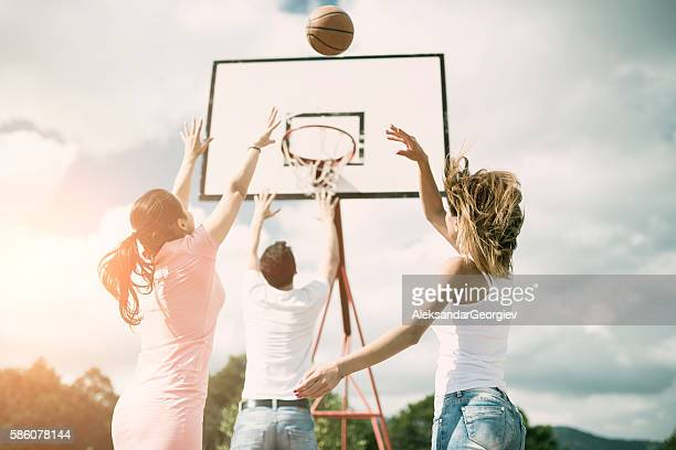 Group of Friends Playing Basketball on Outdoor Court