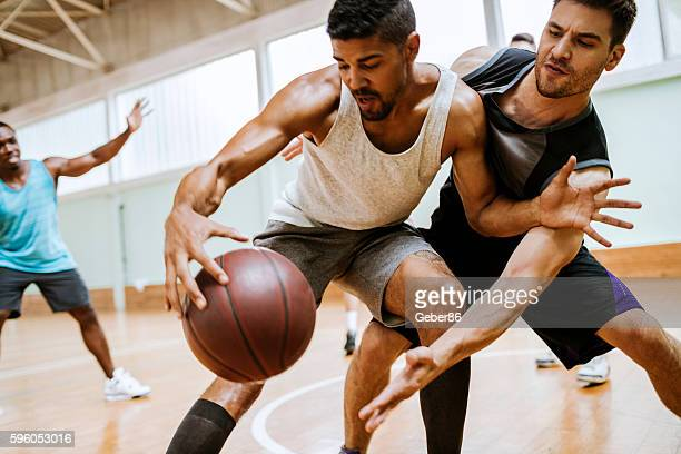 group of friends playing basketball - basketball player stock pictures, royalty-free photos & images