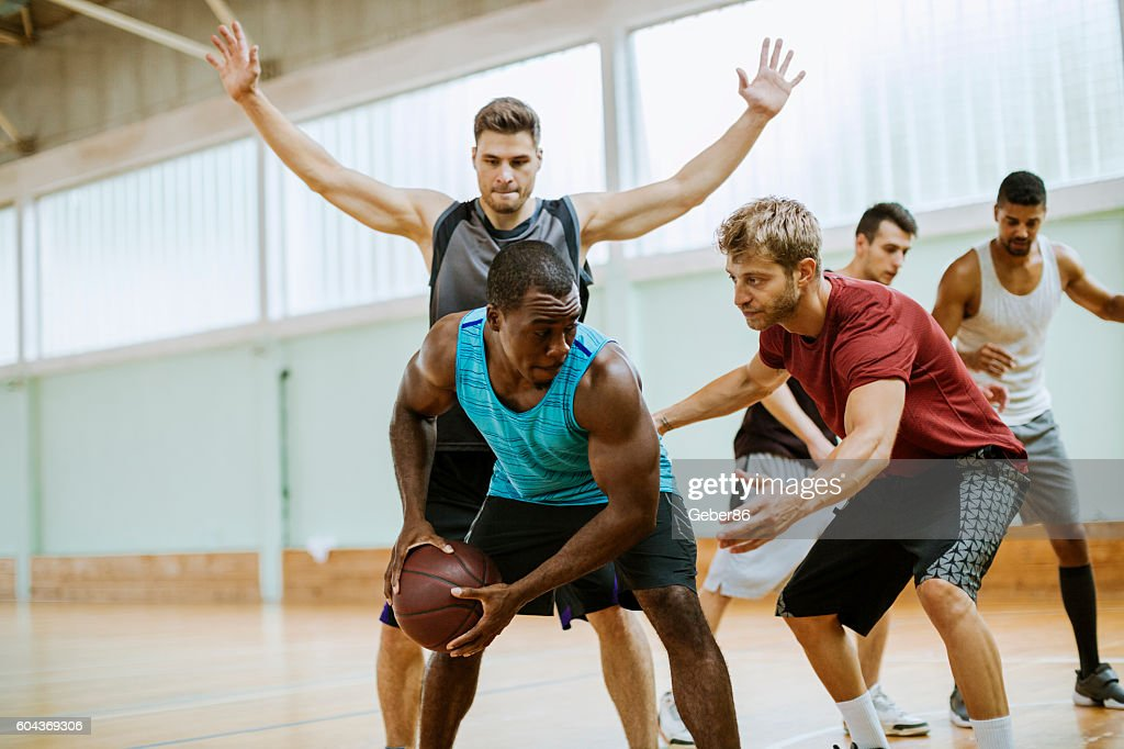 Group of friends playing basketball : Stock Photo