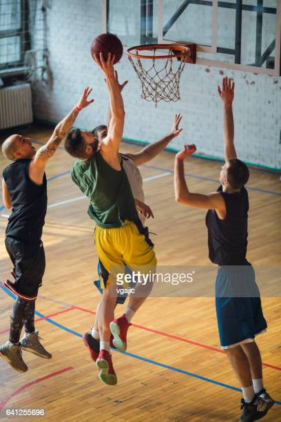 group of friends playing basketball - basketball team stock pictures, royalty-free photos & images