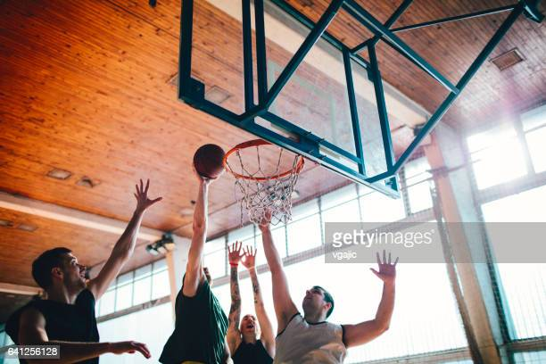 group of friends playing basketball - shooting baskets stock pictures, royalty-free photos & images