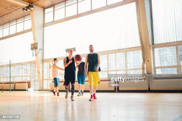 group of friends playing basketball - amateur stock pictures, royalty-free photos & images