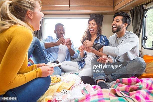 Group of Friends Playing Cards in Caravan