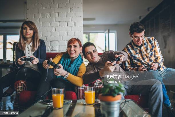 Group of friends playing digital games at home.