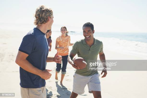 Group of Friends Playing Football