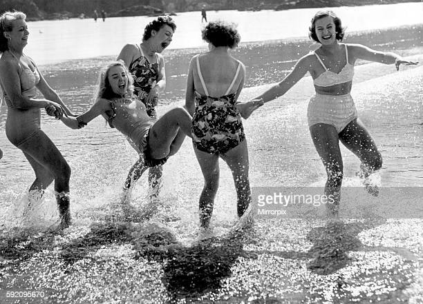 A group of friends playing in the sea at Newquay Cornwall during the Whitsun bank holiday 22nd June 1952