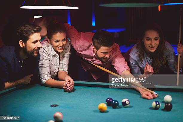 Group of friends playing pool. Cracow, Poland