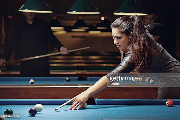 group of friends playing pool in a local pool hall - competition group stock pictures, royalty-free photos & images