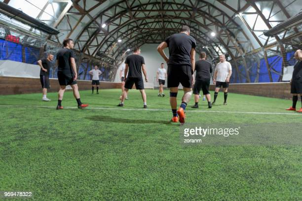 group of friends playing soccer - team sport stock pictures, royalty-free photos & images