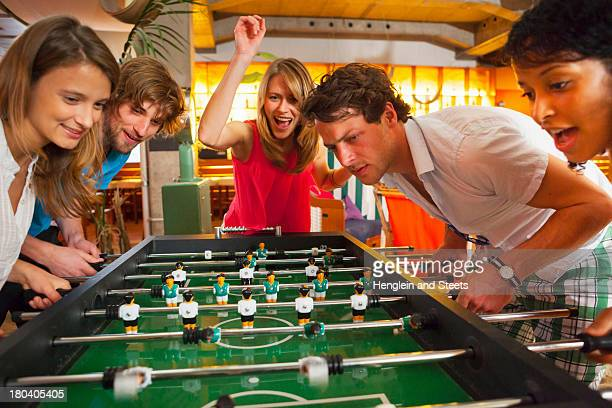 Group of friends playing table football