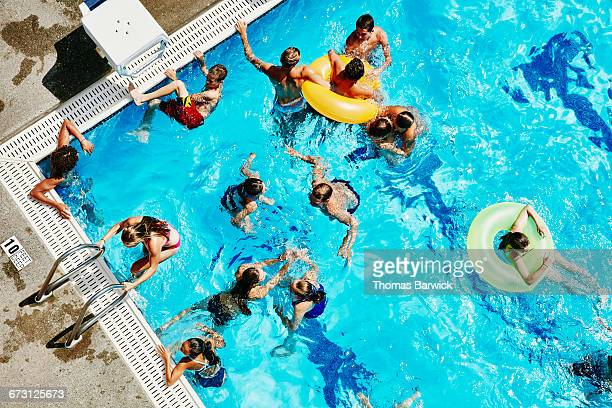 Group of friends playing together in outdoor pool
