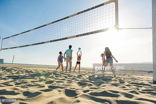 group of friends playing volleyball on beach - la beach stock pictures, royalty-free photos & images