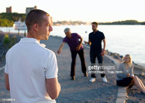 group of friends playing with boule beside sea - ブール ストックフォトと画像