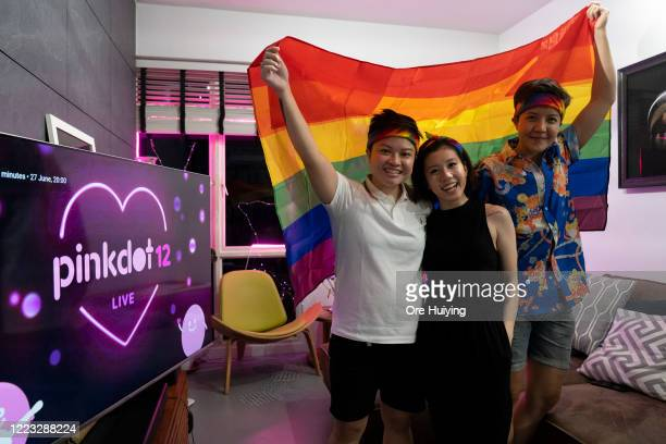 A group of friends pose for a portrait holding up the Progress Flag to show support to the LGBTQ community on June 27 2020 in Singapore Due to the...