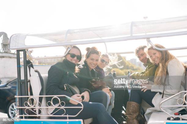 group of friends pose for photo while riding rickshaw - rickshaw stock photos and pictures