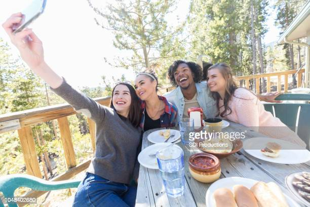 Group of friends pose for selfie