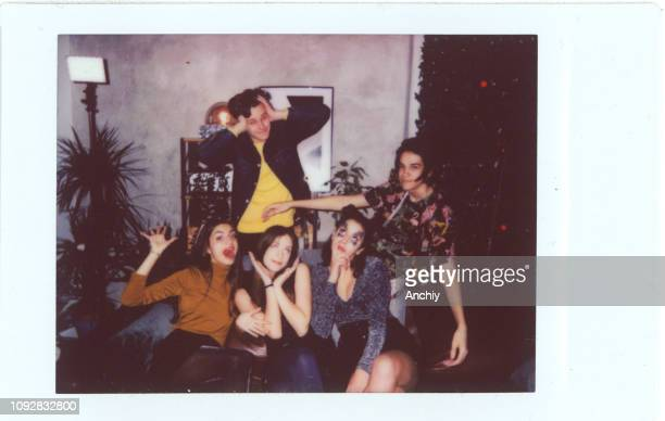 group of friends posing for polaroid party photo - polaroid stock pictures, royalty-free photos & images