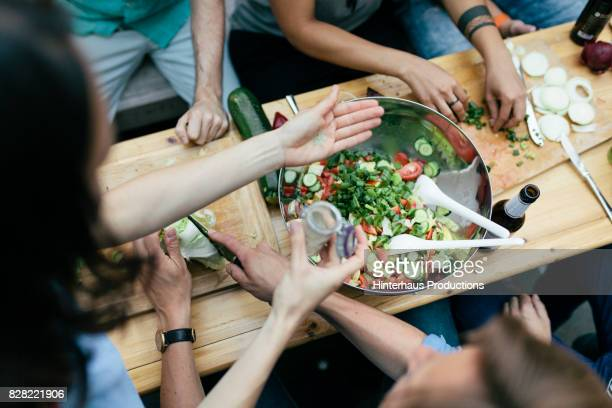 Group Of Friends Preparing Food For Barbecue Together