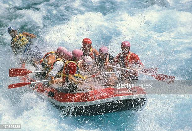 Group of friends rafting on white water