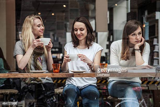 group of friends relaxing at cafe in scandinavia - exclusive stock pictures, royalty-free photos & images