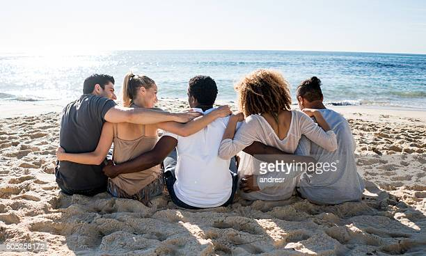 Group of friends relaxing at the beach