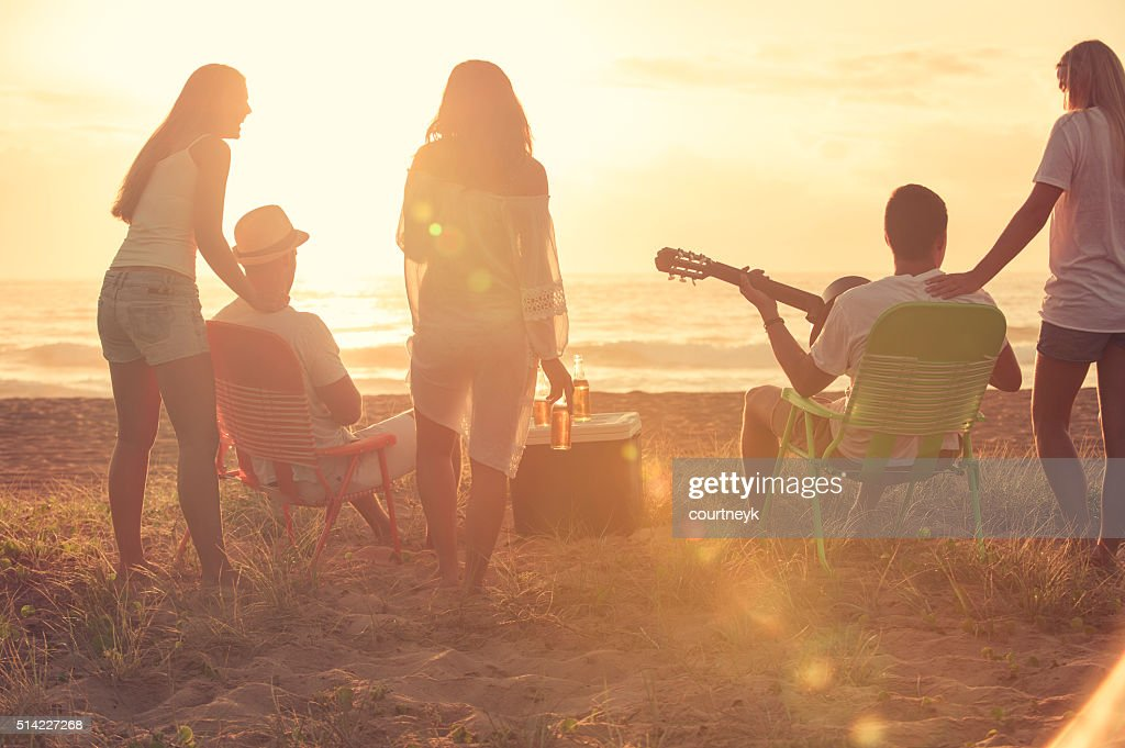 Group of friends relaxing at the beach. : Stock Photo