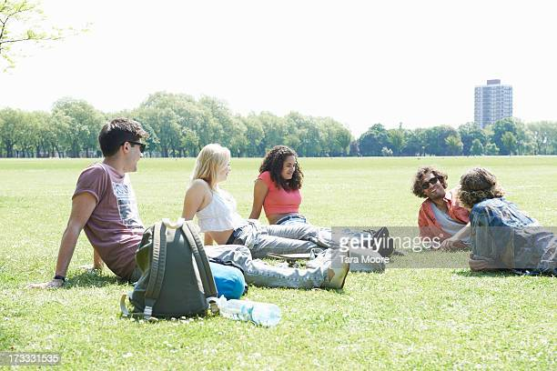 group of friends relaxing in park - gras stock pictures, royalty-free photos & images