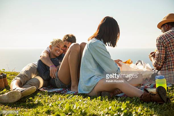 Group of friends relaxing on grass