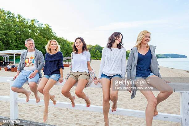 Group of friends relaxing on jetty