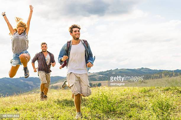 group of friends running free - full stock pictures, royalty-free photos & images