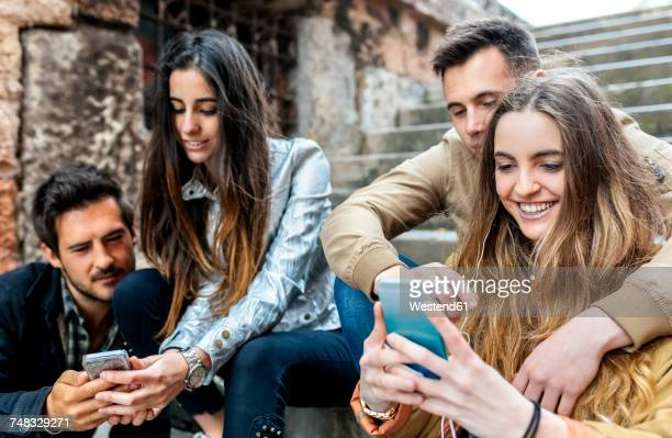 Group of friends sending messages with the smartphone
