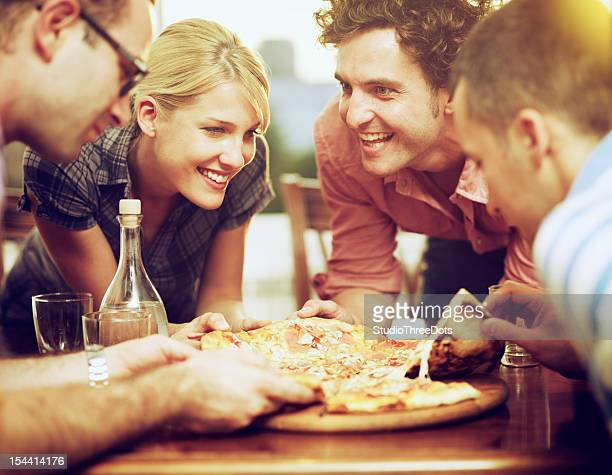 group of friends sharing a pizza