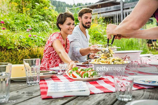 Group of friends sharing picnic lunch, Tyrol, Austria
