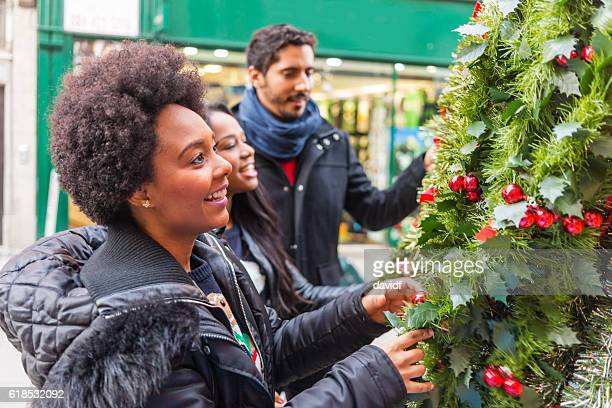 Group of Friends Shopping for a Christmas Tree