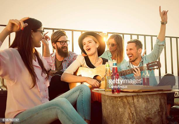 group of friends singing all togheter and having fun
