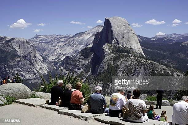 Group of friends sit and have lunch while enjoying Half Dome in Yosemite National Park, Glacier Point