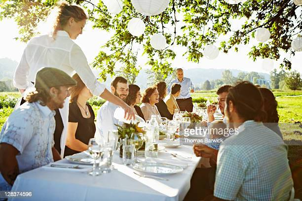 Group of friends sitting around banquet table