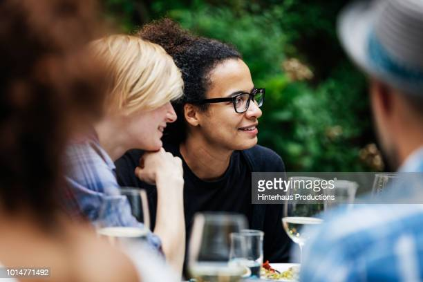 group of friends sitting down at family bbq - lgbtq  and female domestic life fotografías e imágenes de stock