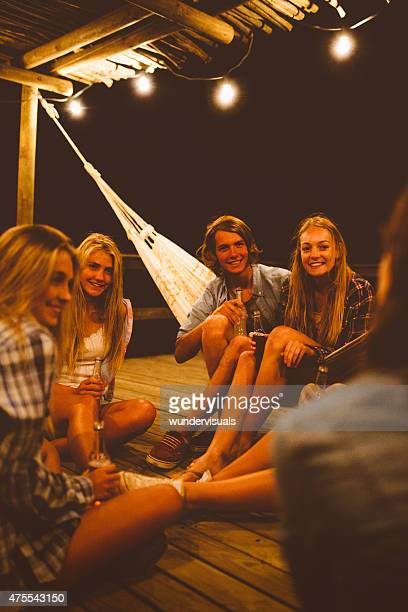 Group of friends sitting on porch at night