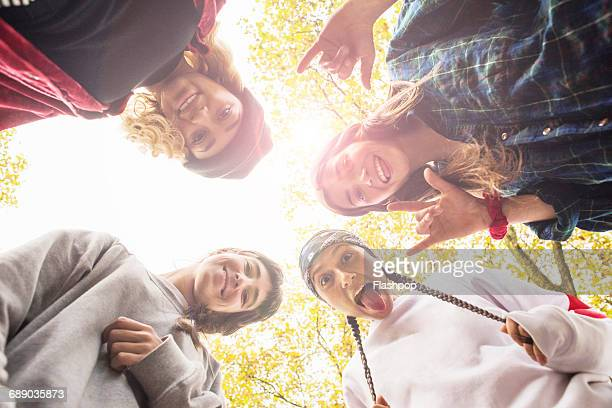 Group of friends skateboarding in park
