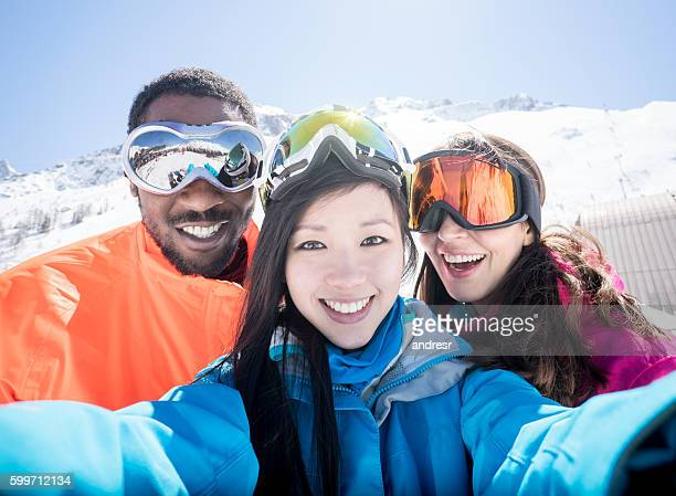 group of friends skiing and taking a selfie - ski goggles stock pictures, royalty-free photos & images